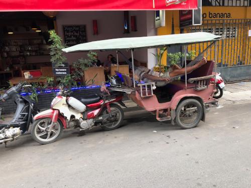Tut tut driver hard at work in Phnom Phen, Cambodia