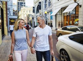 Couple shopping in the King Street Precinct, Perth | TravelManagers Australia