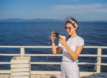 Woman phone on cruise deck