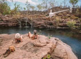 Girls relaxing at Sandy Creek. Image credit: Tourism NT/Lucy Ewing