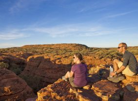 Couple hiking at Kings Canyon. Image credit: Tourism NT/Paddy Pallin